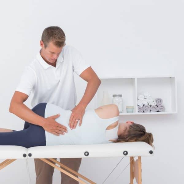 Chiropractic adjustment on back